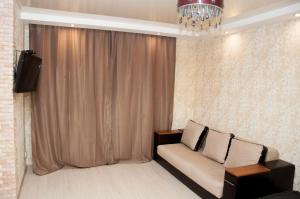 A seating area at Apartment on Bogatyrskaya 6a