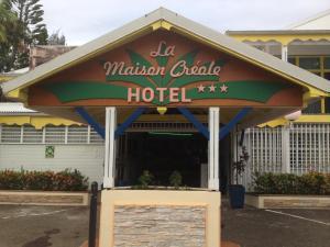 The facade or entrance of Hotel La Maison Creole