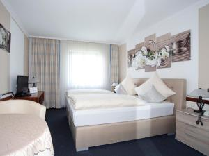Ein Zimmer in der Unterkunft Hotel Garni zum Gockl