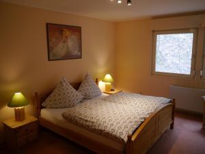 Ein Bett oder Betten in einem Zimmer der Unterkunft Haus Honigstal
