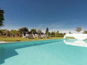 The swimming pool at or near Separate villa in Rouzede with garden