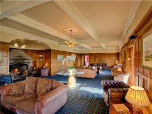 The lounge or bar area at Kincraig Castle Hotel