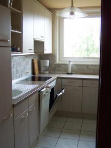 A kitchen or kitchenette at Monteurszimmer Noack