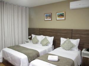 Cama ou camas em um quarto em Hotel & Pousada Princesa Isabel Rua Teresa