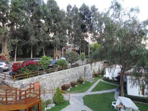 A garden outside El Molino Hotel y Restaurant