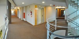 The lobby or reception area at Hotel Aliança Express