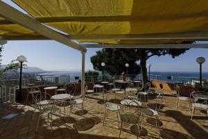 A restaurant or other place to eat at Villa Poseidon Boutique Hotel & Events