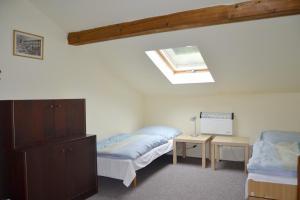 Postel nebo postele na pokoji v ubytování Pension Skalka