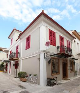 The facade or entrance of Messini Pension