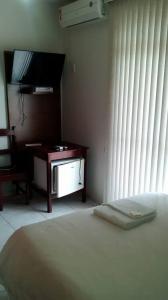 A kitchen or kitchenette at Solar Hotel