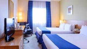 A bed or beds in a room at Holiday Inn London Brent Cross, an IHG Hotel