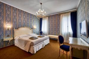 Cama ou camas em um quarto em Hotel Gardena