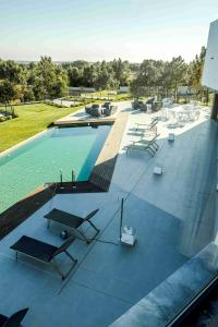 A view of the pool at Enigma - Nature & Water Hotel or nearby