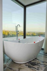 A bathroom at Enigma - Nature & Water Hotel