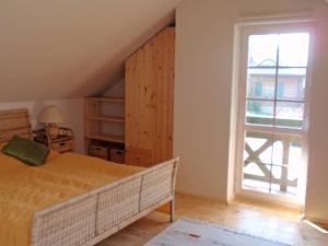 Łóżko lub łóżka w pokoju w obiekcie Holiday Home Kogucik