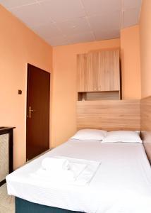 Кровать или кровати в номере Hotel Cascade