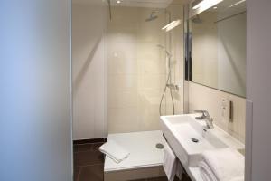 Ein Badezimmer in der Unterkunft Homey! Hotel