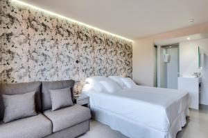 Cama o camas de una habitación en Occidental Ibiza