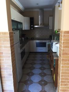 Кухня или мини-кухня в Макс Отель