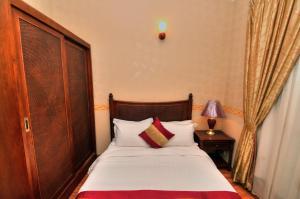 Cama ou camas em um quarto em Raghdan Village
