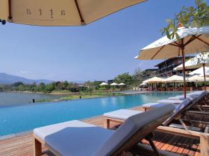 The swimming pool at or near Atta Lakeside Resort Suite