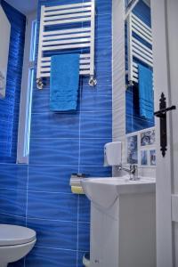Łazienka w obiekcie Apartament MORE