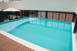 The swimming pool at or close to Palms Ponta Verde by Tropicalis