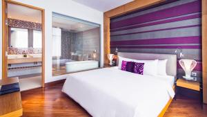 A bed or beds in a room at Grand Mercure Danang