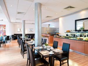 A restaurant or other place to eat at ACHAT Hotel Buchholz Hamburg