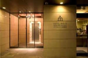 The facade or entrance of Hotel Mid In Meguro Ekimae