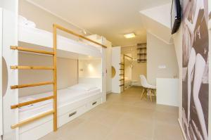 A bunk bed or bunk beds in a room at Hostel Dvor
