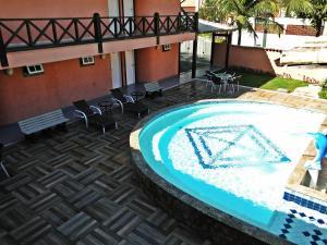 A piscina localizada em Pousada Marbella Inn ou nos arredores