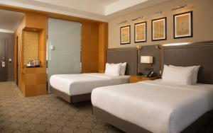 A bed or beds in a room at DoubleTree by Hilton Kazan City Center