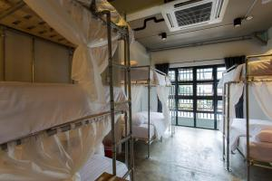 A bunk bed or bunk beds in a room at Bloo Hostel SHA Plus