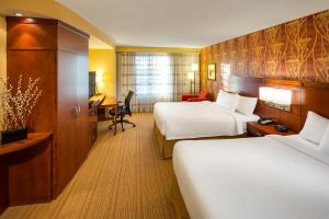 A room at Courtyard by Marriott Calgary Airport