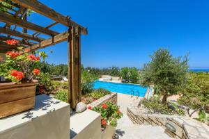 A view of the pool at Eleni Villas or nearby