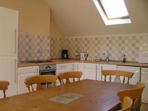 A kitchen or kitchenette at Monzie Villa