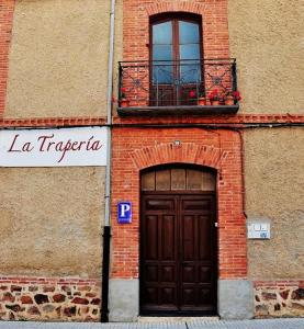 The facade or entrance of La Trapería Hostal - Pensión con encanto