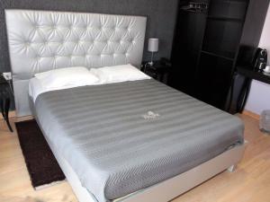 Uma cama ou camas num quarto em Hotel Tulipa
