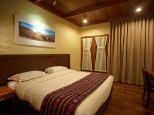 A bed or beds in a room at Jiwa Jawa Resort Bromo