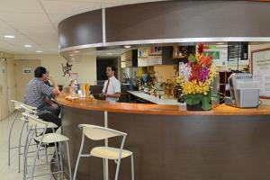 The lounge or bar area at Central Hotel Cayenne