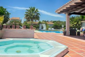 The swimming pool at or near Hotel Malaga Picasso