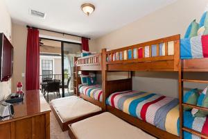A bunk bed or bunk beds in a room at Orlando Family Friendly Home