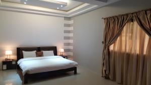 A room at Riviera Taouyah Hotel