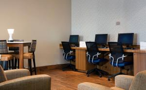 The business area and/or conference room at SpringHill Suites by Marriott Orlando at FLAMINGO CROSSINGS Town Center-Western Entrance