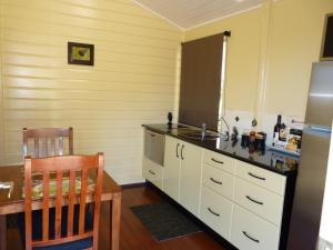 A restaurant or other place to eat at Barking Owl Retreat - Farm Stay - Exclusive to Adults