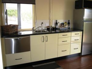 A kitchen or kitchenette at Barking Owl Retreat - Farm Stay - Exclusive to Adults