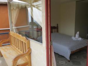 Una habitación en Cabinas Nuestra Kasa