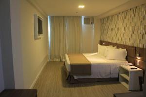 Um quarto em Casa Nova Hotel