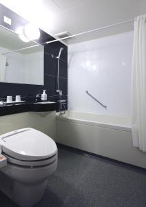 A bathroom at HOTEL UNIZO Osaka Yodoyabashi